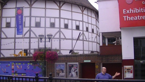 Sam in front of the Globe Theatre.  Give him a spear to carry, he can use it as a walking stick.