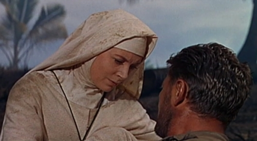 "During their final moments alone together, Sister Angela tends to Mr. Allison's injuries from friendly fire. Although they don't literally pledge love to each other, the film leaves little if any doubt they're in ""some kind"" of love. Critic David Denby has written of Deborah Kerr that she possesses ""an erotic doubleness, a forte for both concealing and revealing a passionate nature."""